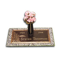 Evergreen Individual Bronze Memorial with retractable vase mounted on a granite base